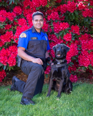 Trooper Alishan Nomani and K9 Buster
