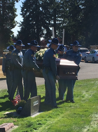 Troopers carry casket to gravesite