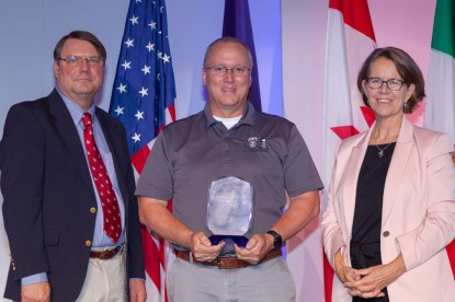 "WSP Captain Tom Foster accepting AAMVA international award for ""Excellence in Government Partnership"""